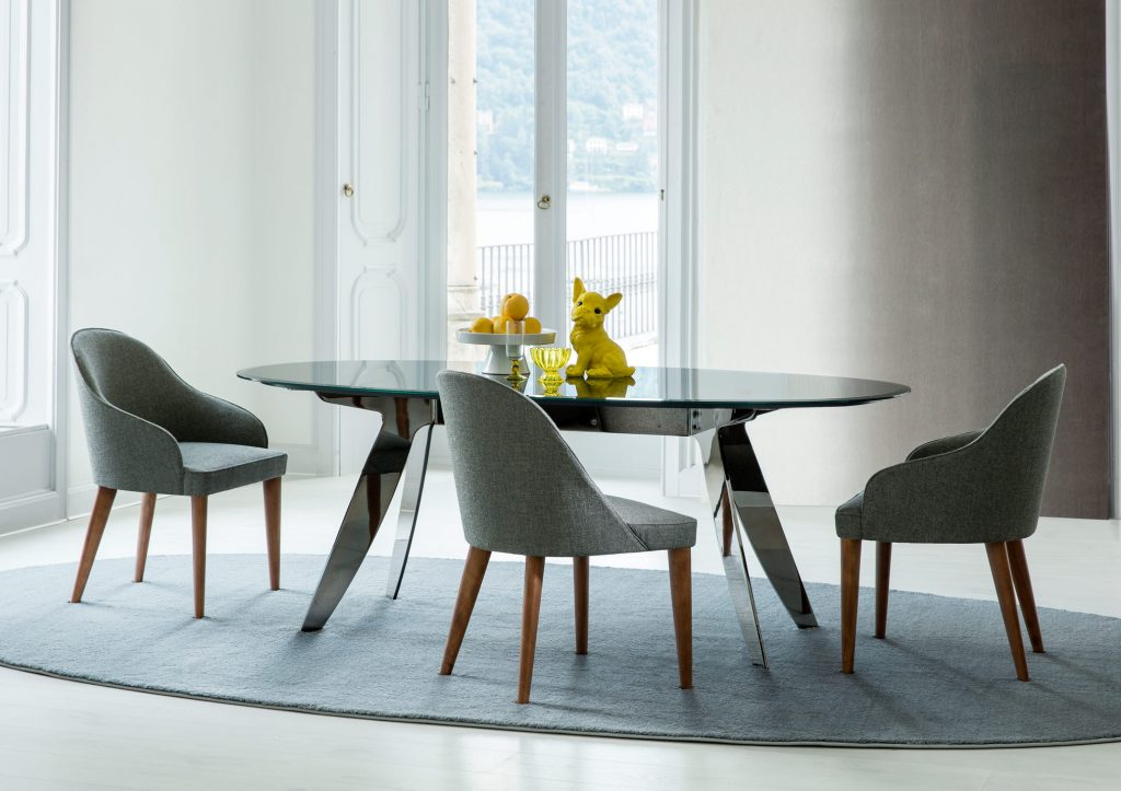 Judy chairs in fabric with smooth wooden legs by BertO