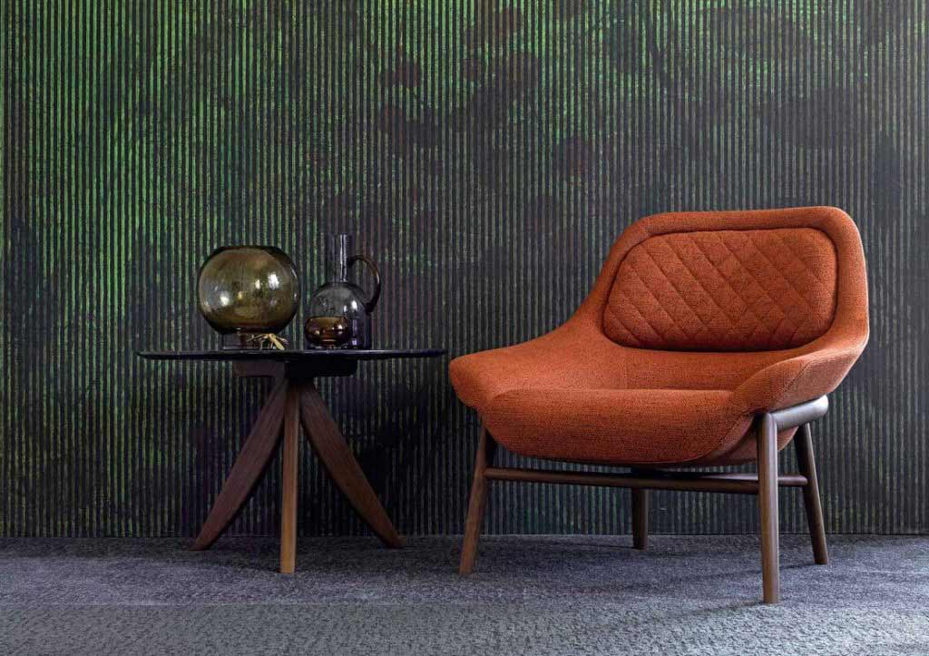 BertO furnishing accessories: Hanna armchair in orange fabric and round Circus coffee table.