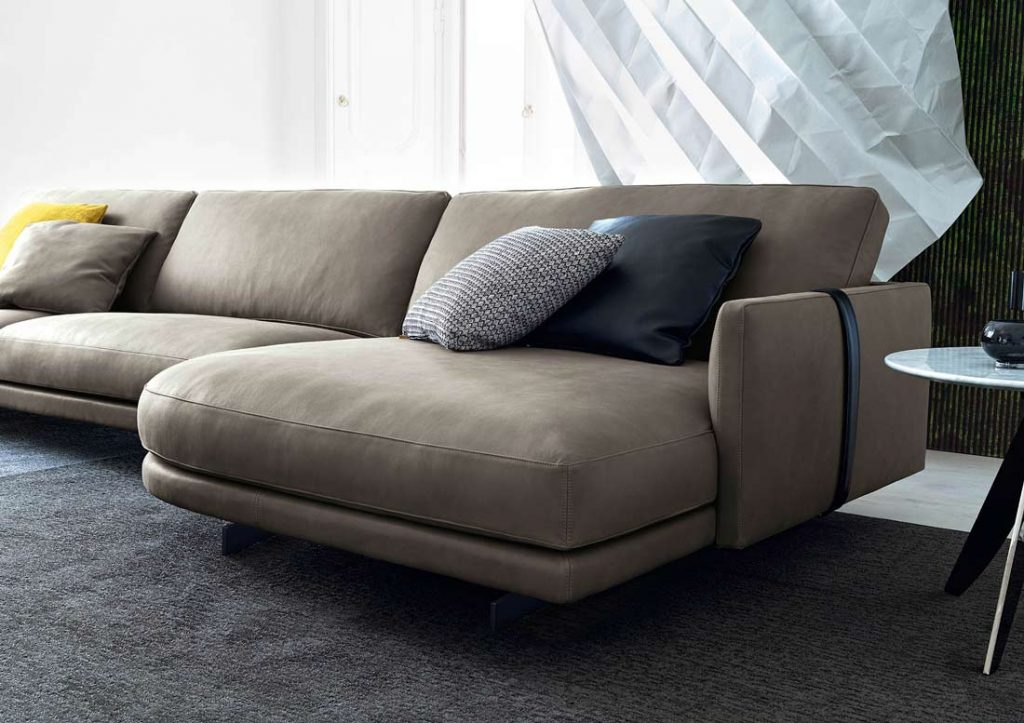 Dee Dee sofa with peninsula and black decorative straps