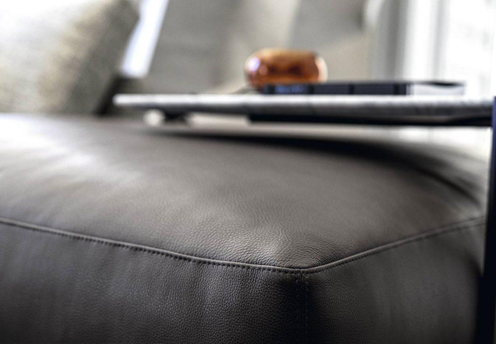 Dee Dee sofa with Rockaway leather pouf by BertO