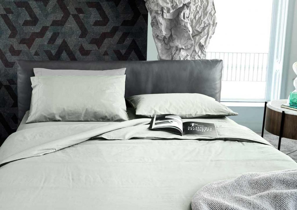 Matching 100%, Stone Washed Yoko green cotton sheets and Soho bed in grey leather