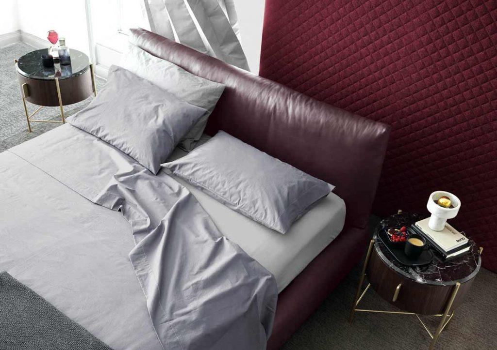 Grey Yoko cotton sheet set elegantly dresses the Soho bed in leather